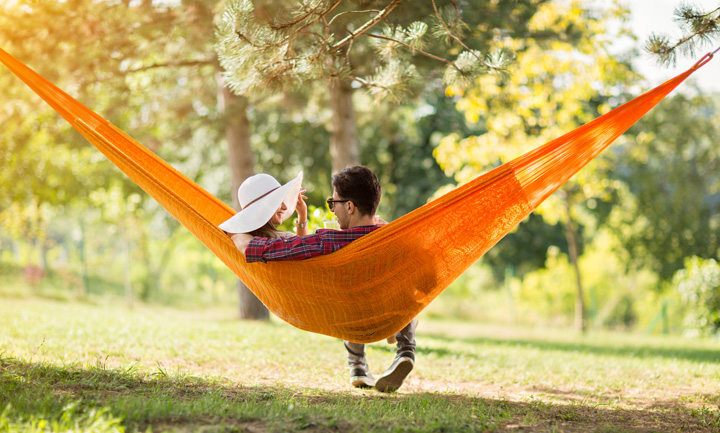 couple in orange hammock