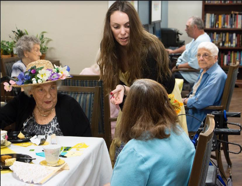 Suncoast Credit Union staff serves treats to residents of Royal Palms Retirement Home