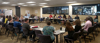 Suncoast employees participate in a roundtable discussion on leadership