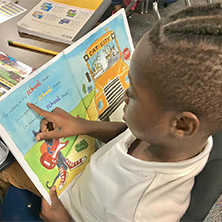 student reads in marion county