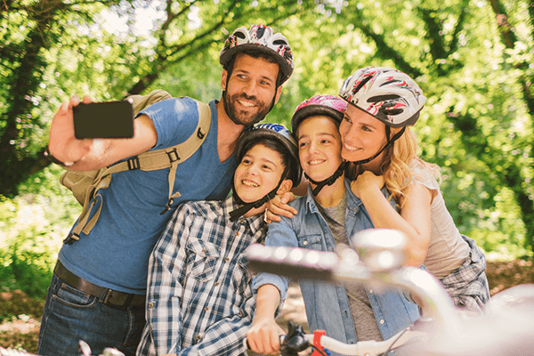The eco-friendly family takes a happy selfie together