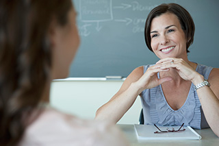 Teacher and parent conference in classroom