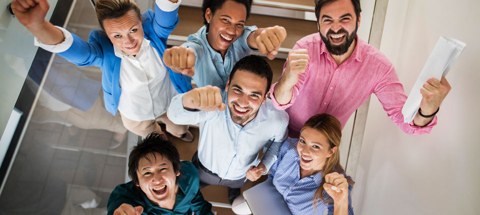 girl with flower in her hair gives two thumbs up