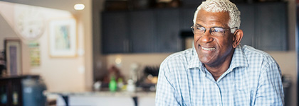 Retirement-age man in his kitchen